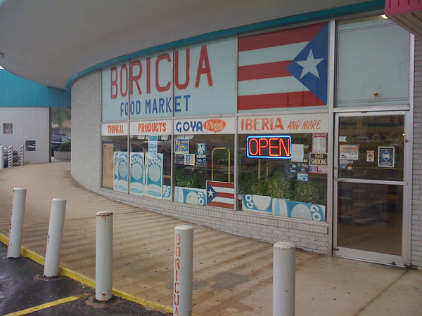 There are other flags painted on behind the big Boricua sign that match the one flag.