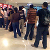 the line at the ATM at the shopping mall on Sunday