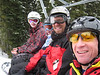 Matthias, Maddy, Dave, and Brian ride the damp chairlift