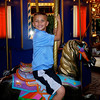 Jack riding the carousel in Boston Common Park