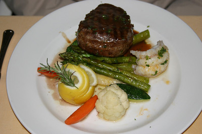 "Peg's ""surf & turf"".  She had a top sirloin as well as a lobster tail.  Even the veggies were delish!"
