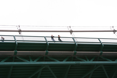 People on the Lions Gate bridge watching the cruise ship pass by.