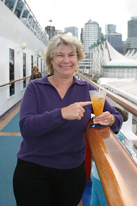 Pegy with a cool drink as we depart Canada Place.