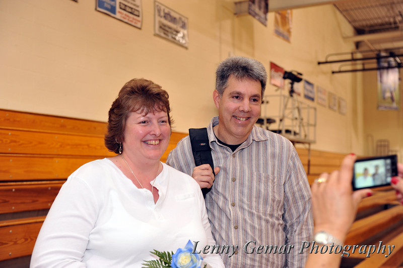 Claire taking photos of Lindsay's parents (Joanne and Danny Meyer).