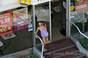 Taylor, yapping on her cellphone, at a Waikiki McDonalds. Where else can you get a Taro pie? She and John went over for some munchies, and to use their wireless Internet.