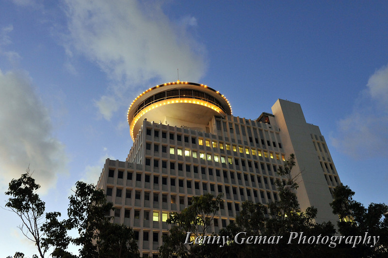 """""""The UFO has landed.""""<br /> Sunset on Waikiki, with the revolving restaurant towering high above us (Top of Waikiki)."""