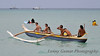 An outrigger canoe tour heads out to sea...