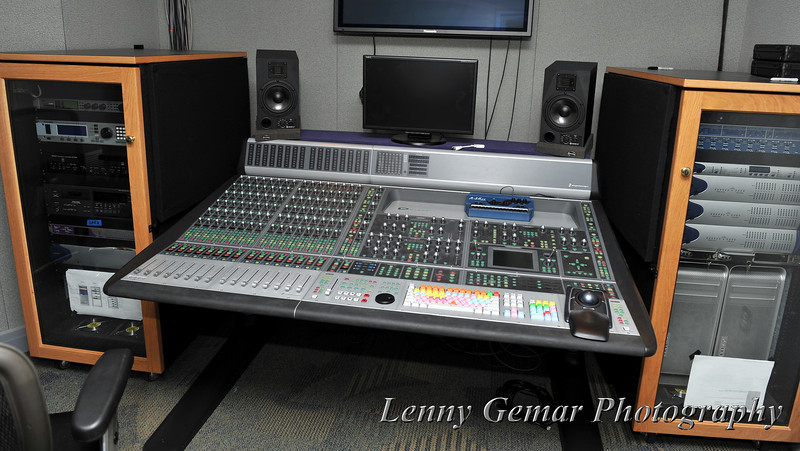 Performance Studio control room. There is a large performance studio (downstairs) where larger acts with crowds of fans can attend. This room is where the recording and on-air product are managed.
