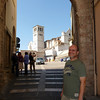entering the courtyard of St Francis basilica in Assisi