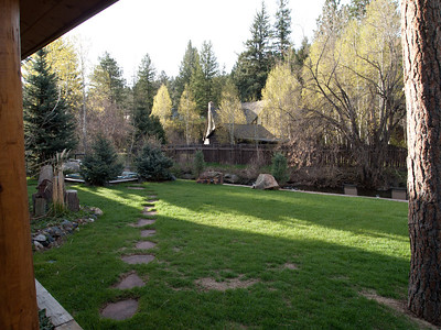 5/22 - This is the view from the back porch.  The stepping stones lead to the hot tub.  The patio overlooking Bear Creek is to the right.