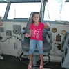 Kennedy in the Captain's chair on the bridge
