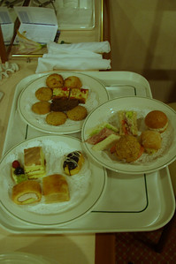 The subsequent plates includes finger sandwiches and bite sized desserts.