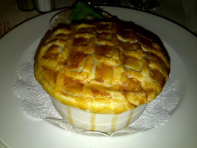 Don't know what Princess called this dish, but it was like a pot pie filled with shrimp etouffee.  The sauce inside was YUM.  It could have used a little more heat!