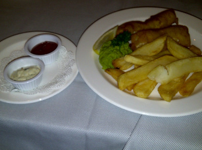 Fish & chips accompanied with mashed peas.