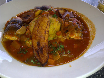 flying fish with cou cou.  Both flying fish and cou con are staples of the Bajan cuisine.  The three are draped along the side of the dish.  It also includes plantains.  The fish-based sauce was delish!