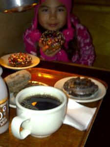 Kari happy with her old fashioned chocolate doughnut.