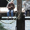 fishing on the pier next to the ferry