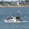 fishing boat coming into the harbor at Pt Judith