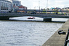 River Liffey with a river tour boat..