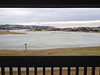 Looking out the balcony of our Timeshare unit.  The lake is frozen over by a very thin layer of ice.