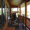 all the cabins, which were arranged loosely around the main lodge, had porches with rocking chairs.