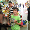 Ryan holding a dried water snake, which a vendor had dozens for sale.