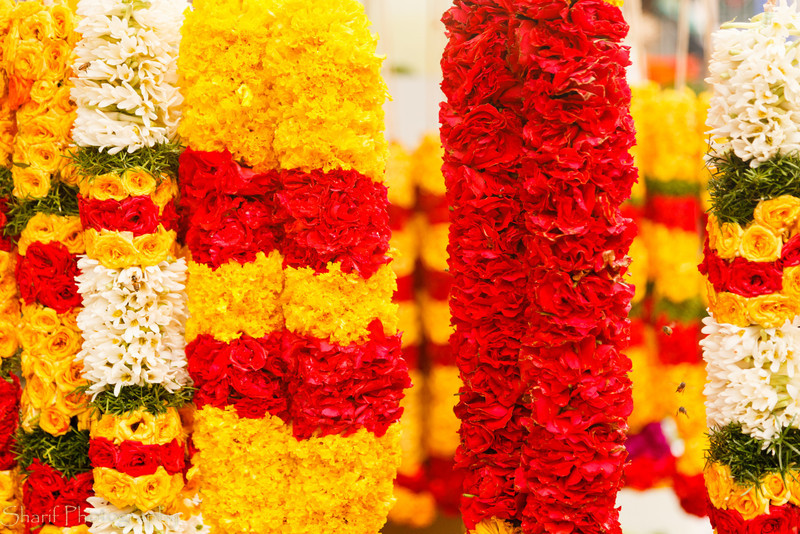 Flower garlands are sold on the street in Singapore for religious purposes.