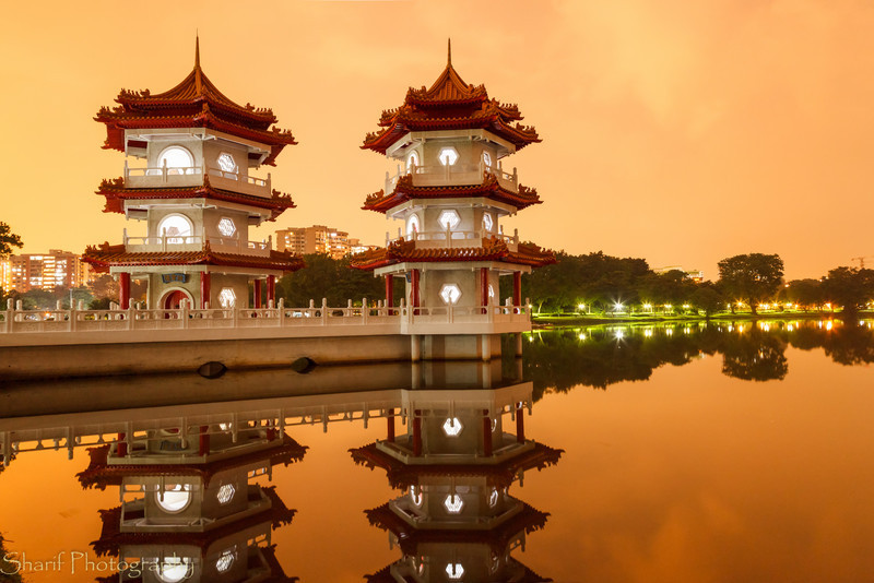 Twin Pagodas reflecting in pond