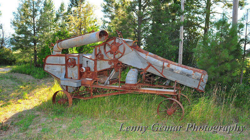 An interesting looking old piece of farm machinery. A baler, perhaps?