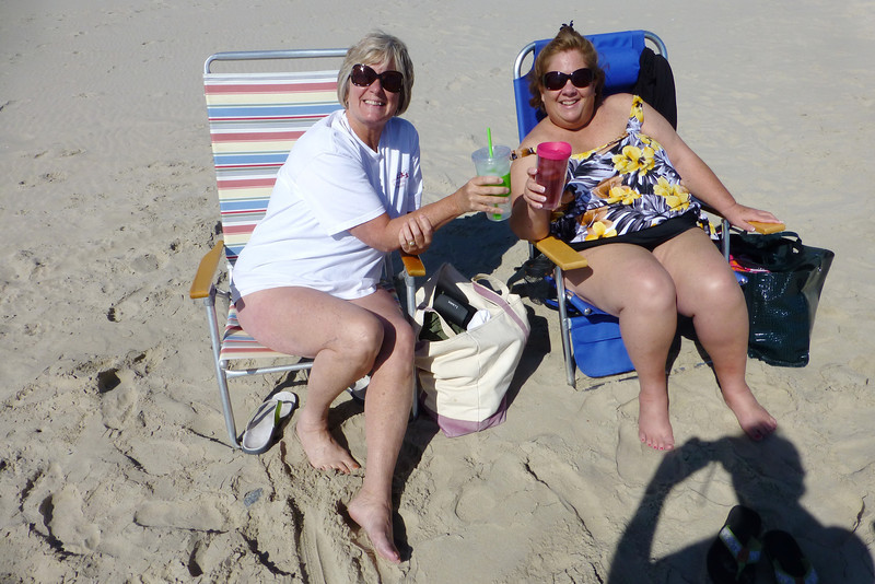 Kris and Susie toasting to good weather.    The Shadow knows.