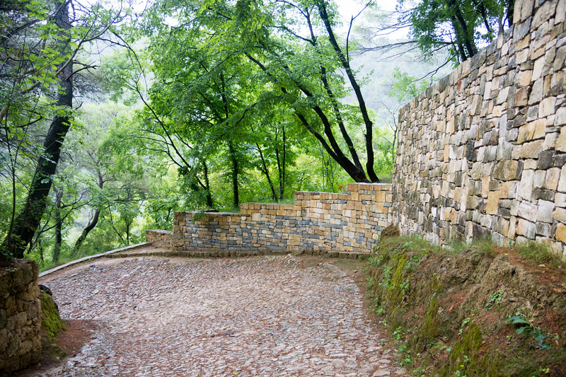 Stone wall with cobblestone road