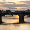 Sunset over bridge on the Arno