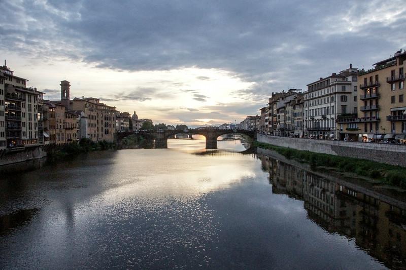 Sunset over bridge on the Arno