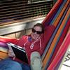 Julie reads in the hammock