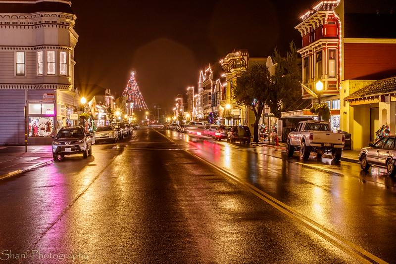 Main street lit up in the rain