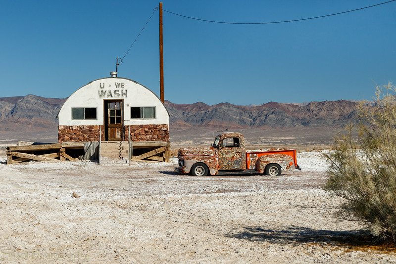 Defunct laundromat and truck