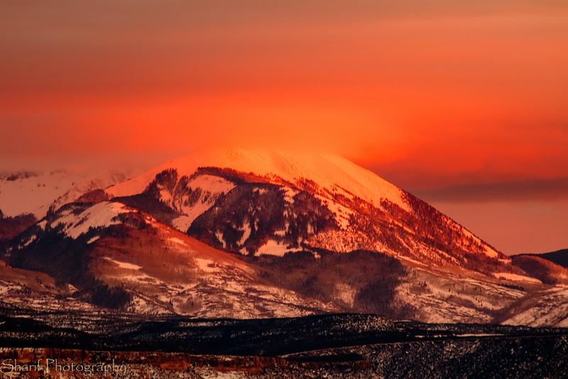 Mountain glow reflected in cloud
