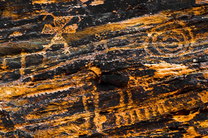 "Petroglyphs with the ""mystical batwoman"" (top left)"