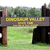 JoAnn at the entrance of Dinosaur Valley State Park