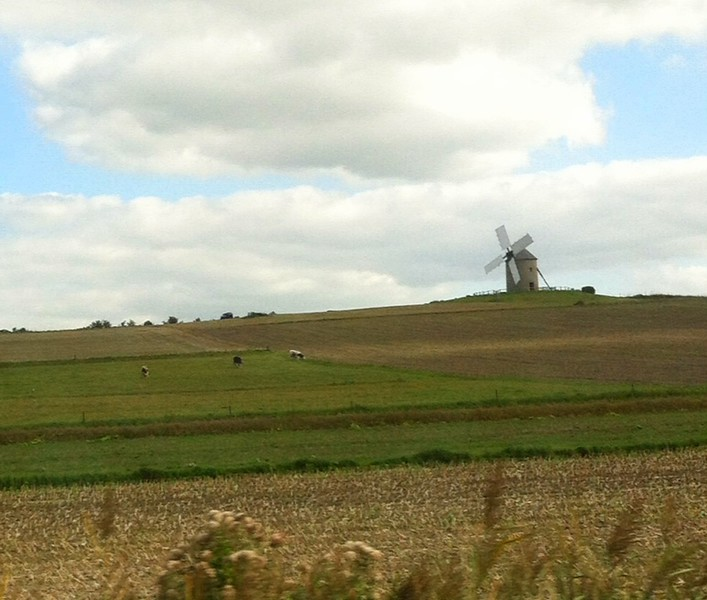 Was only about 30-40 minutes from Fougeres toward St Malo, then a right turn to Mont St Michel. When we got within a few miles of it, we could see the spire. However, we also saw this out-of-place windmill on the drive out there.