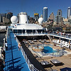 Sundeck, pool, jacuzzi and Seattle from the top deck