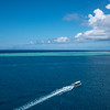 Another tour boat cruising out to a motu; just can't believe the waters were so blue