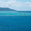 Sail boats anchored just off shore from Raiatea