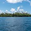 An islet (motu) surrounding the larger island of Raiatea