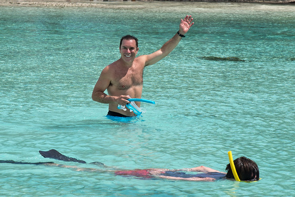Randy waving while Charley swims the swallow waters