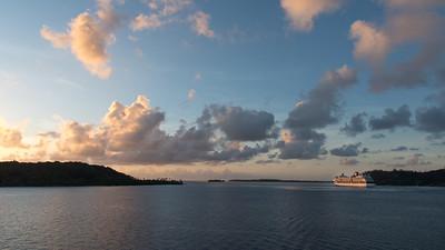 Another cruise ship leave Bora Bora at sunset