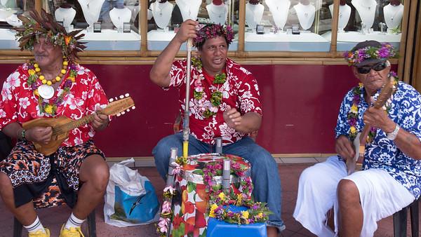 Words escape me; locals entertain the tourists in Bora Bora's port shopping area