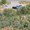 That is our car, the dark blue van.  This is zoomed in from way up the trail.  The next picture gives more perspective.