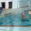 Tony swims at our hotel: Allamanda Beach Resort