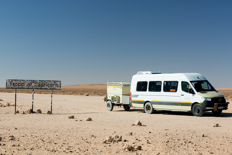 Our bus at the Tropic of Capricorn sign
